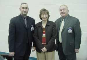 After a substance abuse seminar presented by the N.E.O.A., Amity Regional Office of Curriculum and Staff Development Secretary Beth Moffat thanks N.E.O.A. Speaker Officer Scott Duva and N.E.O.A. Director of Community Affairs and Narcotics Trainer Tom Janette.