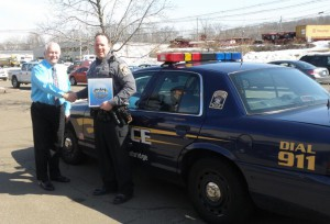 N.E.O.A. Community Affairs Director Tom Janette presents Woodbridge D.A.R.E. Officer Vincent Lynch with a complimentary copy of the HRM video Pharm Parties: A Lethal Mix. Officer Lynch stopped by the N.E.O.A. office to pick up some drug educational materials to distribute in Woodbridge.