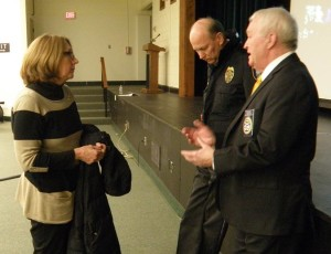 N.E.O.A Community Affairs and Designer Drug speaker Tom Janette speaks with a Newtown parent as former Newtown Chief of Police Michael Kehoe listens in.